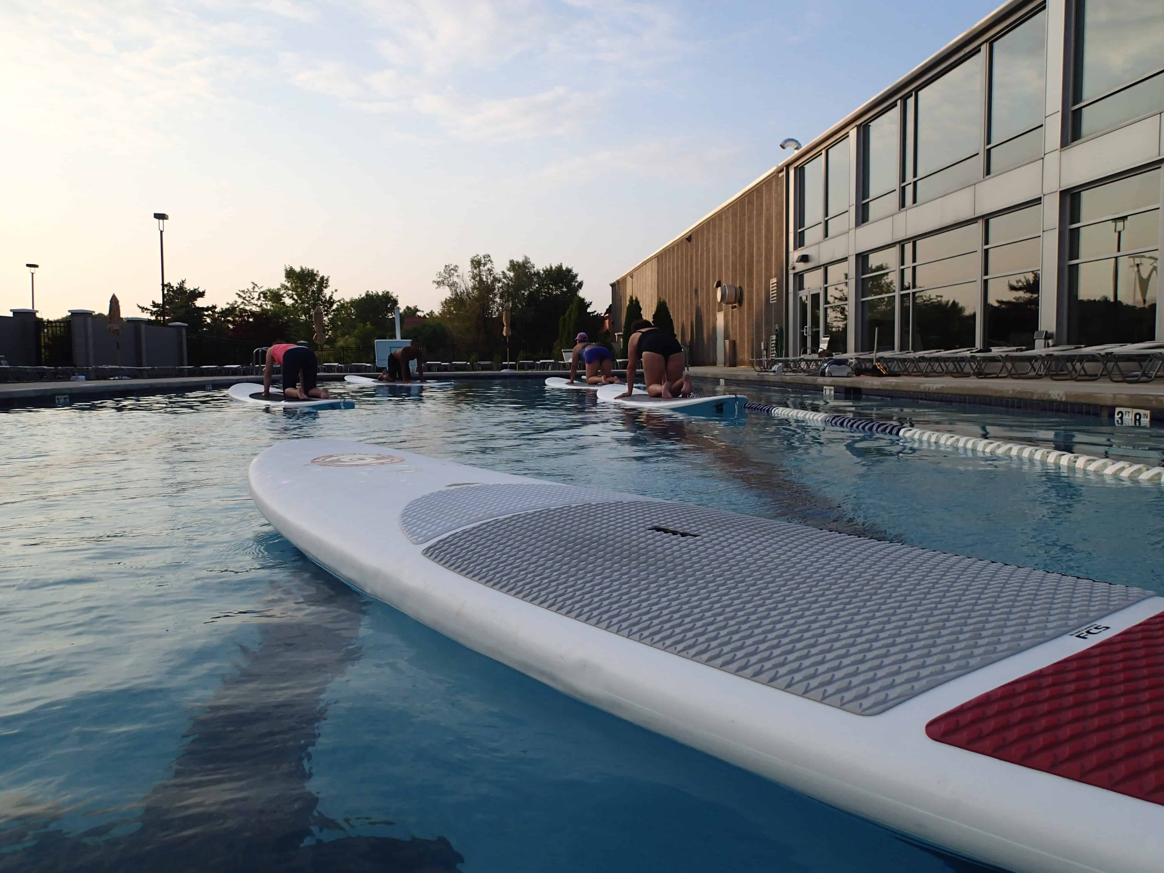 Stand Up Paddle Board Yoga at Elite Sports Clubs