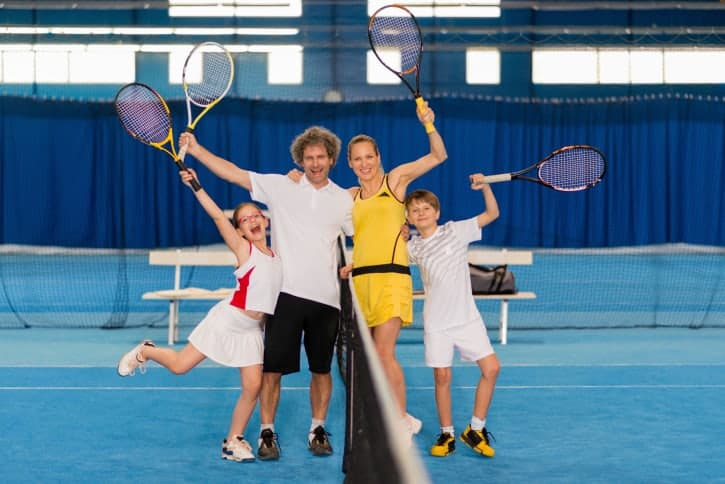 Family Playing Indoor Tennis